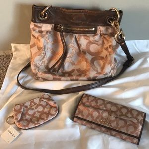 Rose gold COACH purse wallet and coin purse.